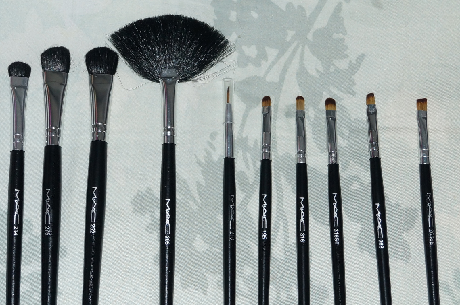 mac brushes. my girlfriend daughter just give her this mac brushes set that she never use. i wonder anyone can confirm is real bushes and the leather case. mac